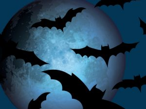 Halloween Repeating Pattern with Bats Flying in Front of the Moon