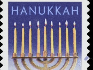 2009 USA postage stamp with a Hanukkah menorah on it containing 9 lit candles.