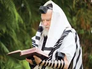 Rabbi Praying with tallis and tefillin